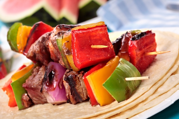 Tasty bbq skewer with beef and vegetables Free Photo