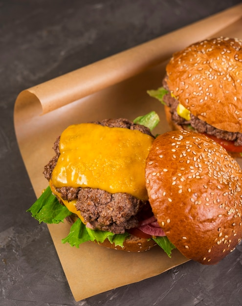 Tasty beef burgers with melted cheese Free Photo