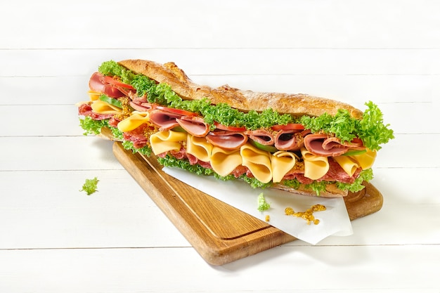 Tasty big sandwich on white Free Photo