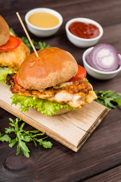 Tasty burger with onion and sauces Free Photo