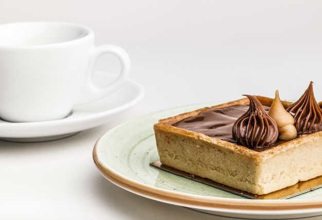 Tasty cakes and tea  on table, close-up Premium Photo