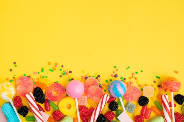 Tasty candies assortiments on table Free Photo
