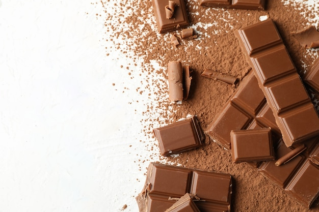 Tasty chocolate and powder on white background. sweet food Premium Photo