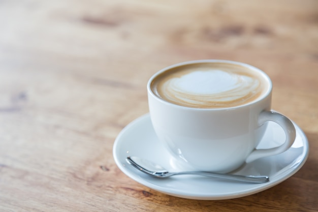 Tasty coffee in a white cup Free Photo
