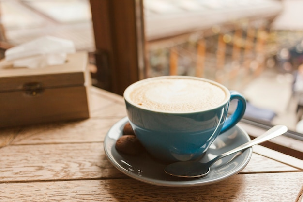 Tasty coffee with delicious cookies on wooden table Free Photo