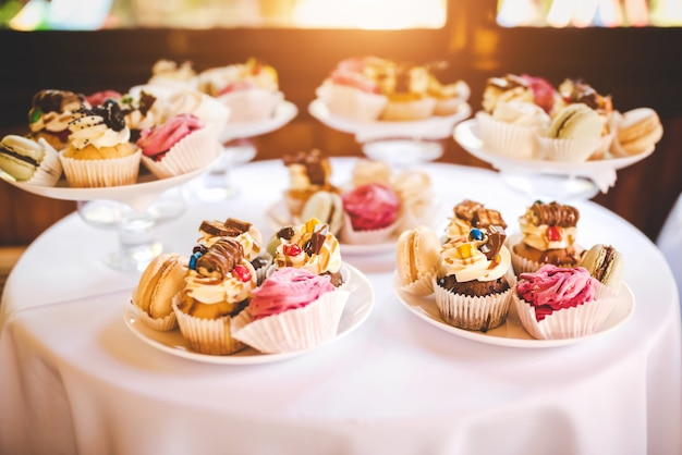 Tasty colorful desserts on the birthday party Premium Photo