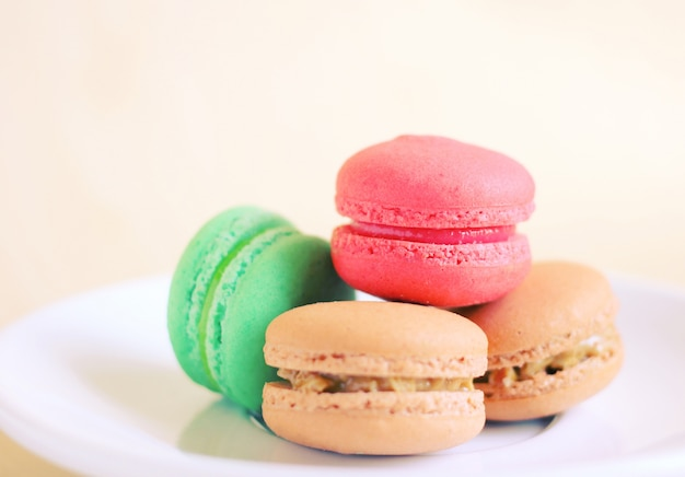 Tasty colorful macaroons with retro filter effect Free Photo
