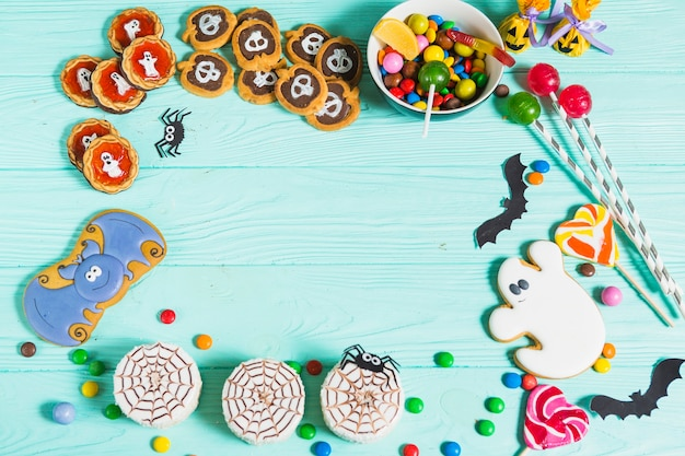 Tasty different biscuits, gingerbread, lollipops and sweeties Free Photo