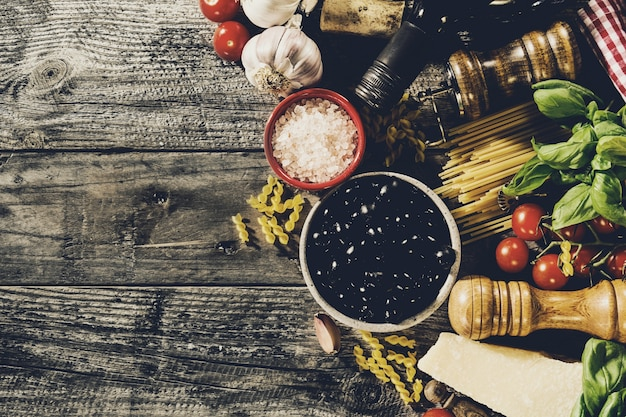 Tasty Fresh Appetizing Italian Food Ingredients On Old Rustic Wooden Background Ready To Cook