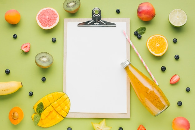 Tasty fruit and juice frame with clipboard Free Photo