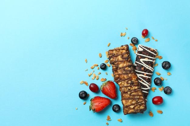 Tasty granola bars on blue background, top view Premium Photo