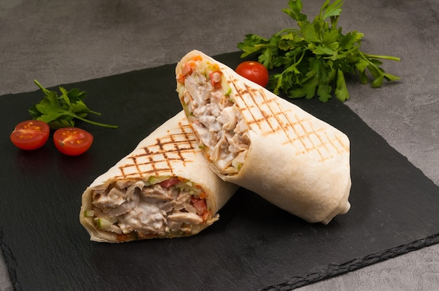 Tasty grilled shawarma with chicken and vegetables Premium Photo