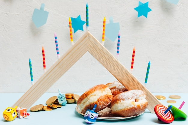 Tasty hanukkah doughnuts on a table Free Photo