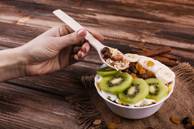 Tasty healthy morning breakfast made of milk and porridge with nuts kiwis and honey 8353 6126