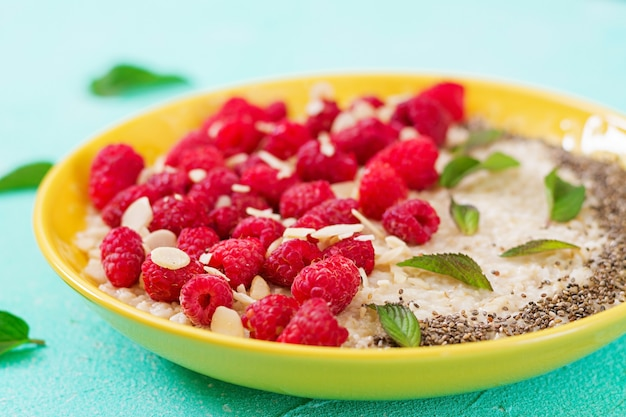 Tasty and healthy oatmeal porridge with raspberry and flax chia. healthy breakfast. fitness food. proper nutrition Free Photo