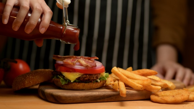 Tasty homemade bacon burger with french fries Premium Photo