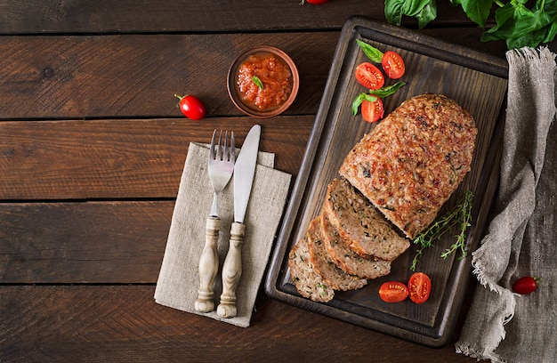 Tasty homemade ground  baked turkey meatloaf on wooden table. Free Photo