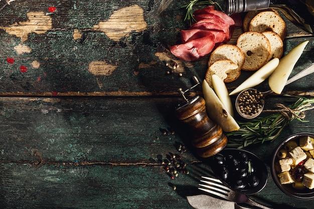 Tasty italian greek mediterranean food ingredients top view on green old rustic table above Free Photo