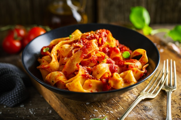 Tasty italian pizza with tomato sauce and parmesan Premium Photo