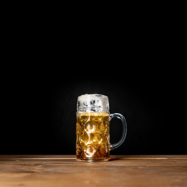 Tasty mug of bavarian beer with black background Free Photo
