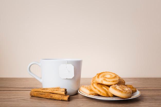 Tasty pastry and cinnamon sticks Free Photo