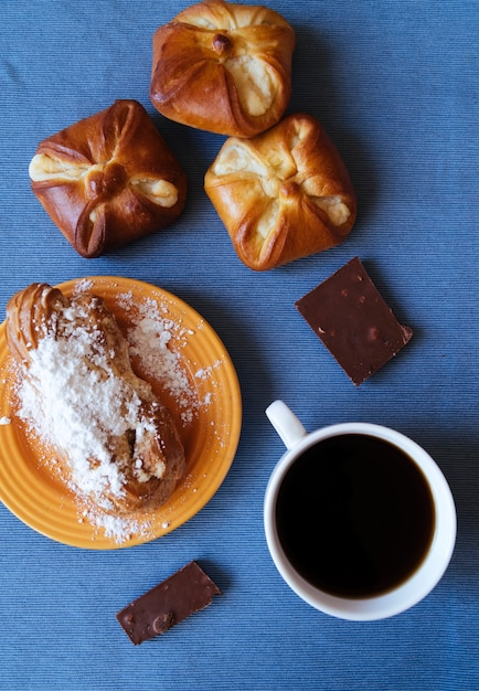 Tasty pastry and coffee breakfast top view Free Photo