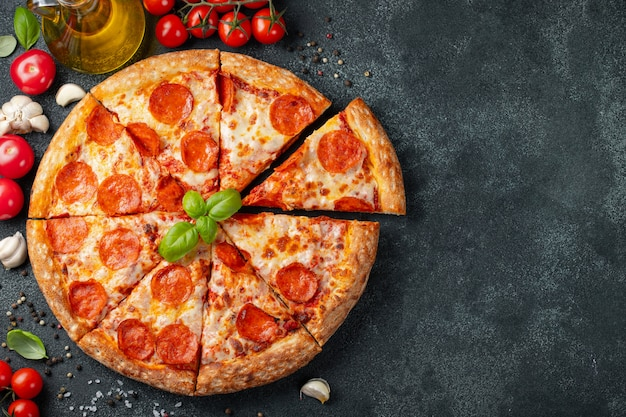 Tasty pepperoni pizza and cooking ingredients Premium Photo