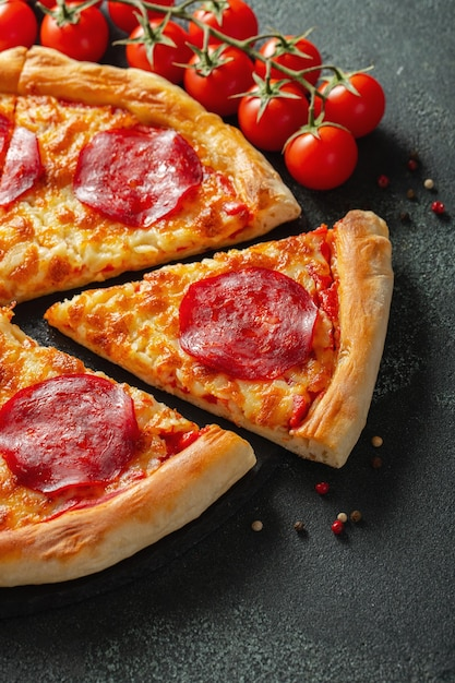 Tasty pepperoni pizza and cooking ingredients. Premium Photo