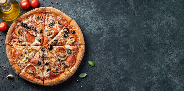 Tasty pepperoni pizza with mushrooms and olives. Premium Photo