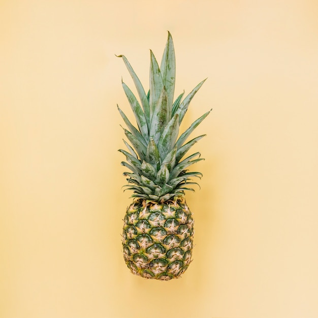 Tasty pineapple on yellow background Free Photo