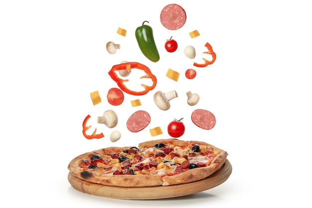 Tasty pizza and ingredients isolated on white Premium Photo
