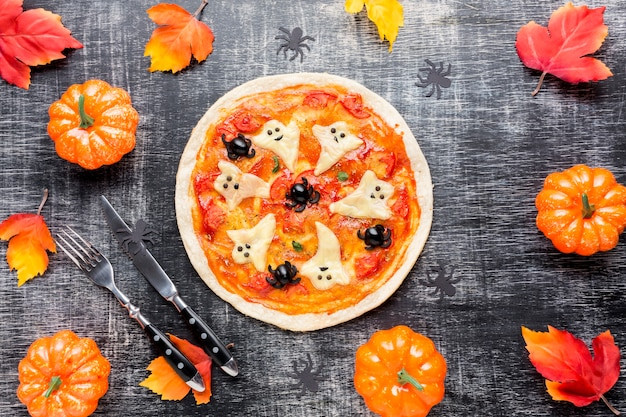 Tasty pizza surrounded by halloween elements Free Photo