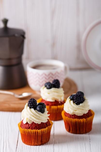 Tasty red velvet cupcakes. Premium Photo