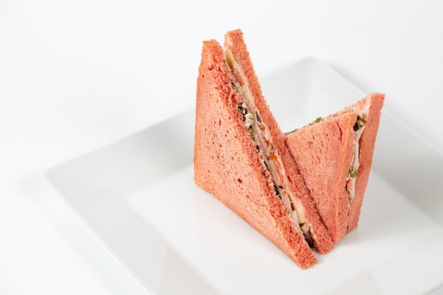 Tasty sandwich with pink bread on a white plate Free Photo
