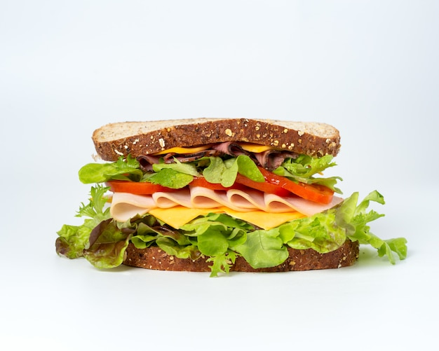 Tasty sandwich with vegetables, ham and cheese Free Photo