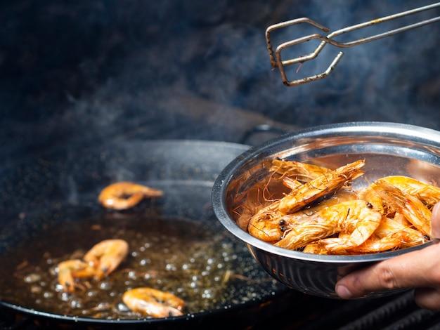 Tasty shrimps fried on pan Free Photo