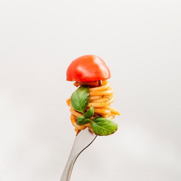 Tasty spaghetti wrapped around fork Free Photo