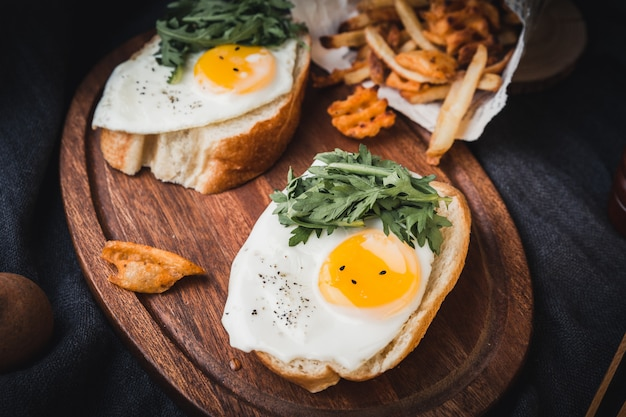 Tasty toasts with fried eggs Free Photo