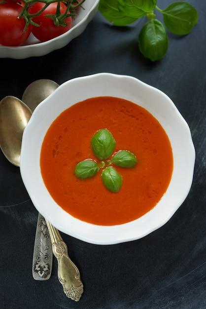 Tasty tomatoe soup top view. Premium Photo