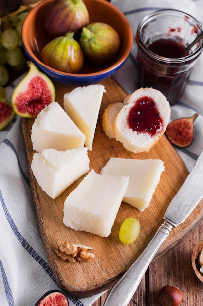 Tasty variety of snacks and cheese on a table Free Photo
