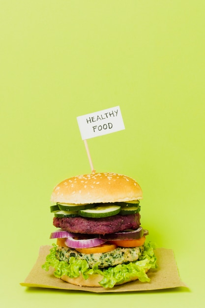 Tasty vegan burger with healthy food sign Free Photo