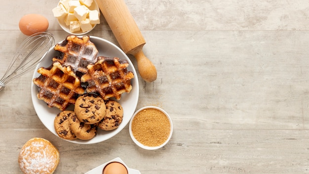 Tasty waffles and cookies with copy space Free Photo