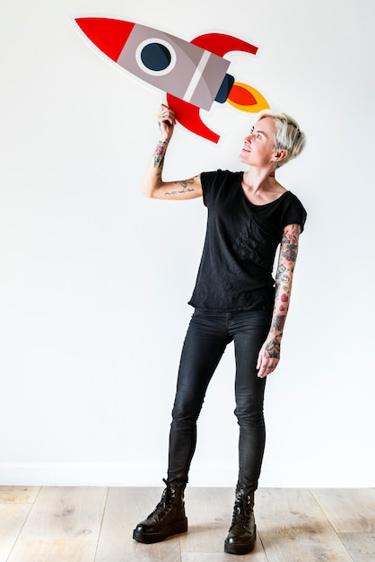 Tattooed woman holding rocketship icon Premium Photo