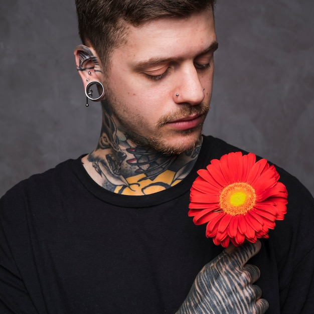 Free Photo Tattooed Young Man With Ears And Nose Piercing