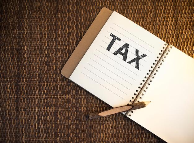 Tax written on a notebook Premium Photo