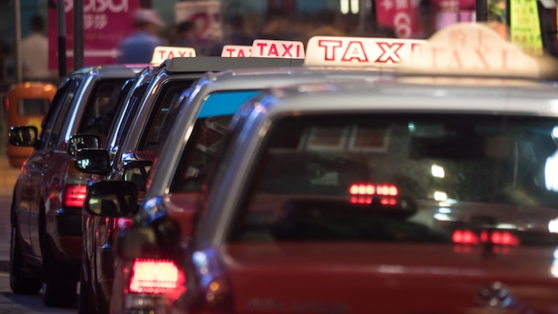 Taxi cars parked in row at night Premium Photo