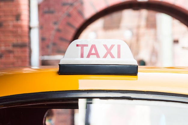 Taxi sign on roof top car Free Photo