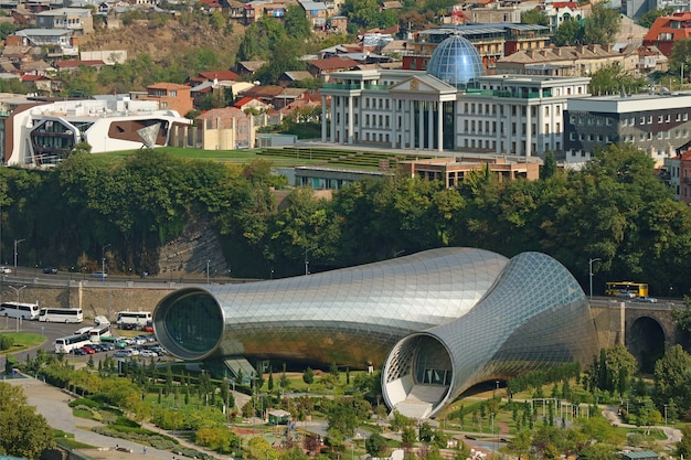 Tbilisi music theater and exhibition hall in rhike park with the ceremonial palace of georgia Premium Photo