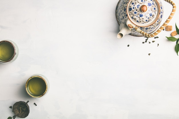 Tea composition on grey, flat lay Premium Photo