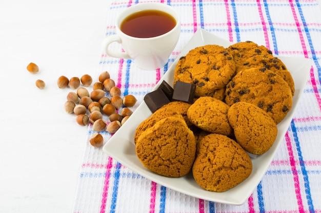 Tea, cookies and hazelnuts Premium Photo